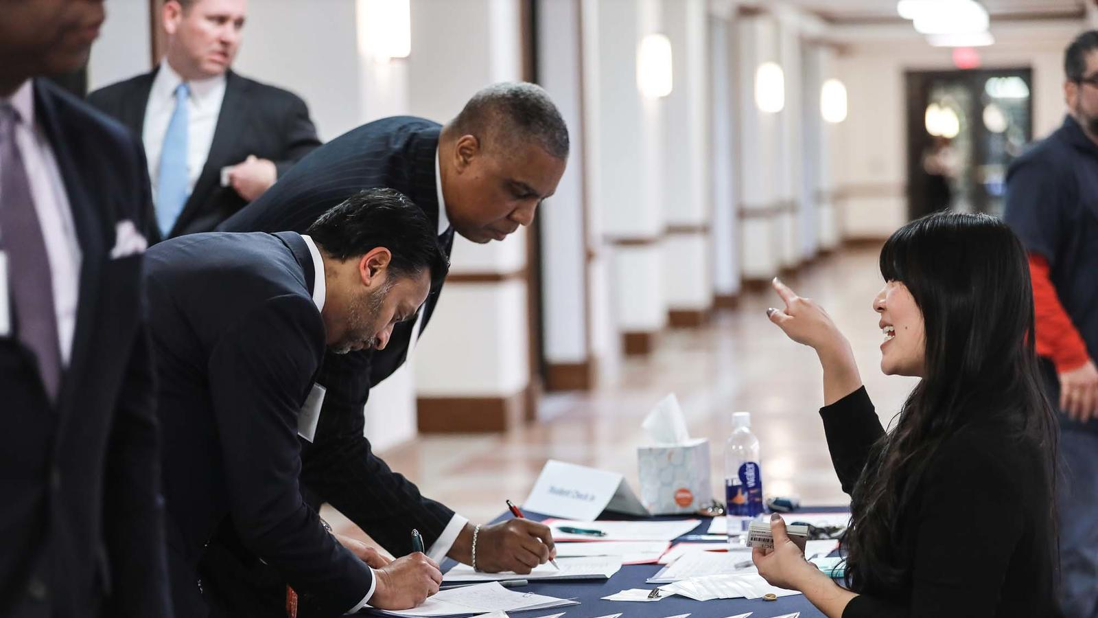 Recruiters signing into networking event
