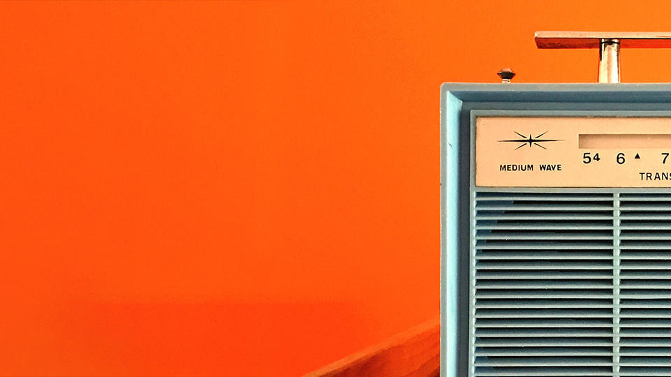 Vintage radio on an orange background