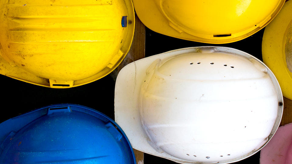 Photo of hardhats taken from above.