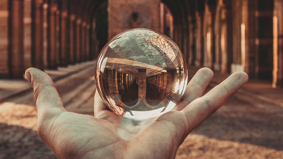 Holding a crystal ball in front of a hallway