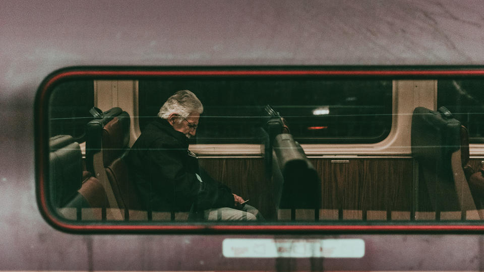Man sitting in a train