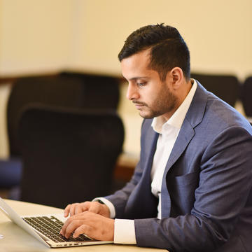 Man in suit working on computer